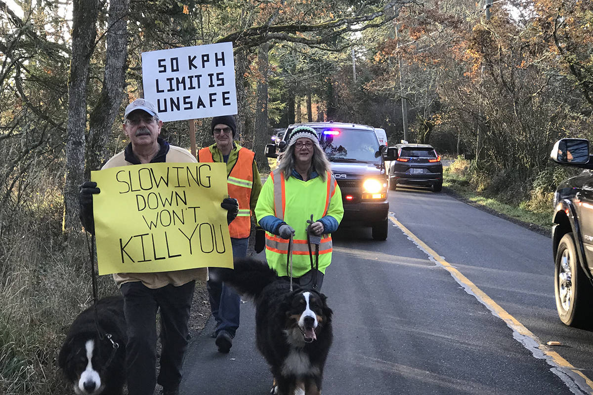 Residents march along Prospect Lake Road to bring attention to unsafe conditions